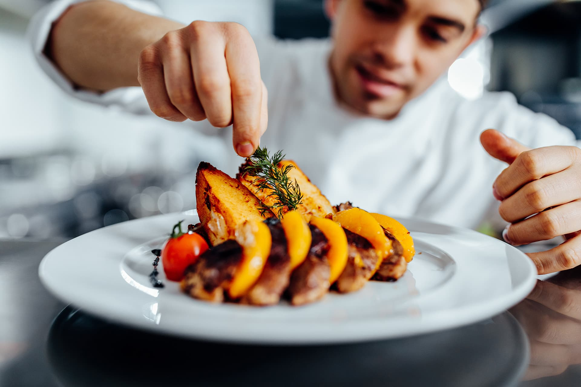 Chef adding seasoning onto sweet potatoes at restaurant with restaurant insurance