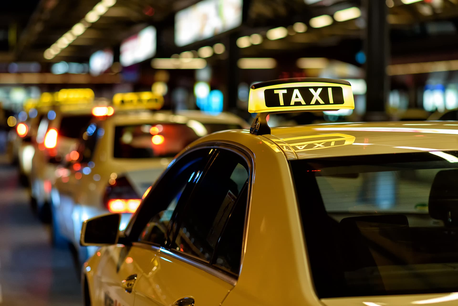 Taxis in a line, covered by commercial auto insurance
