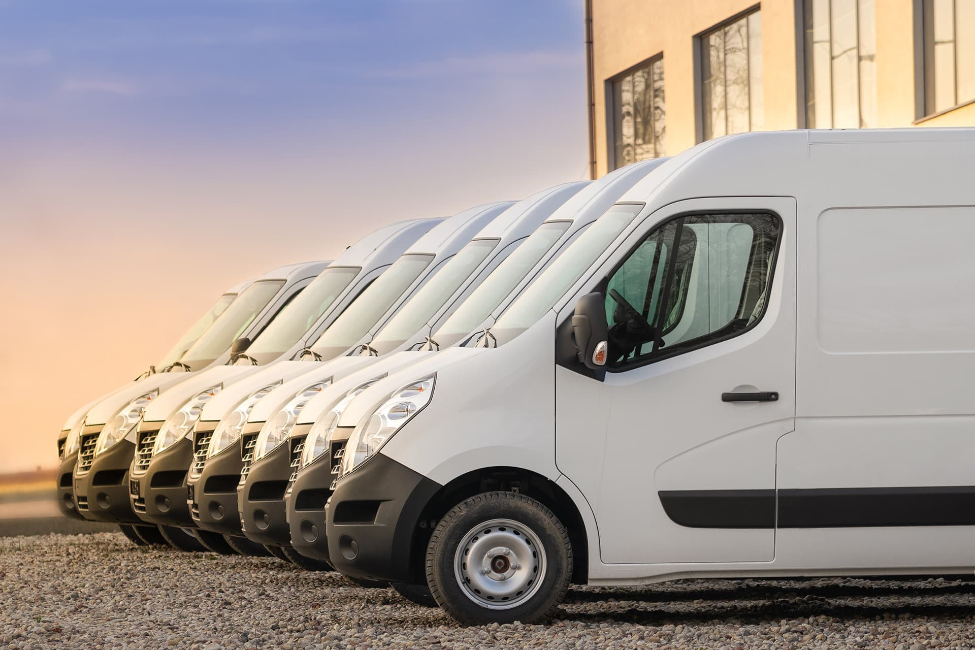 Auto fleet insurance for 7 work vans outside a building