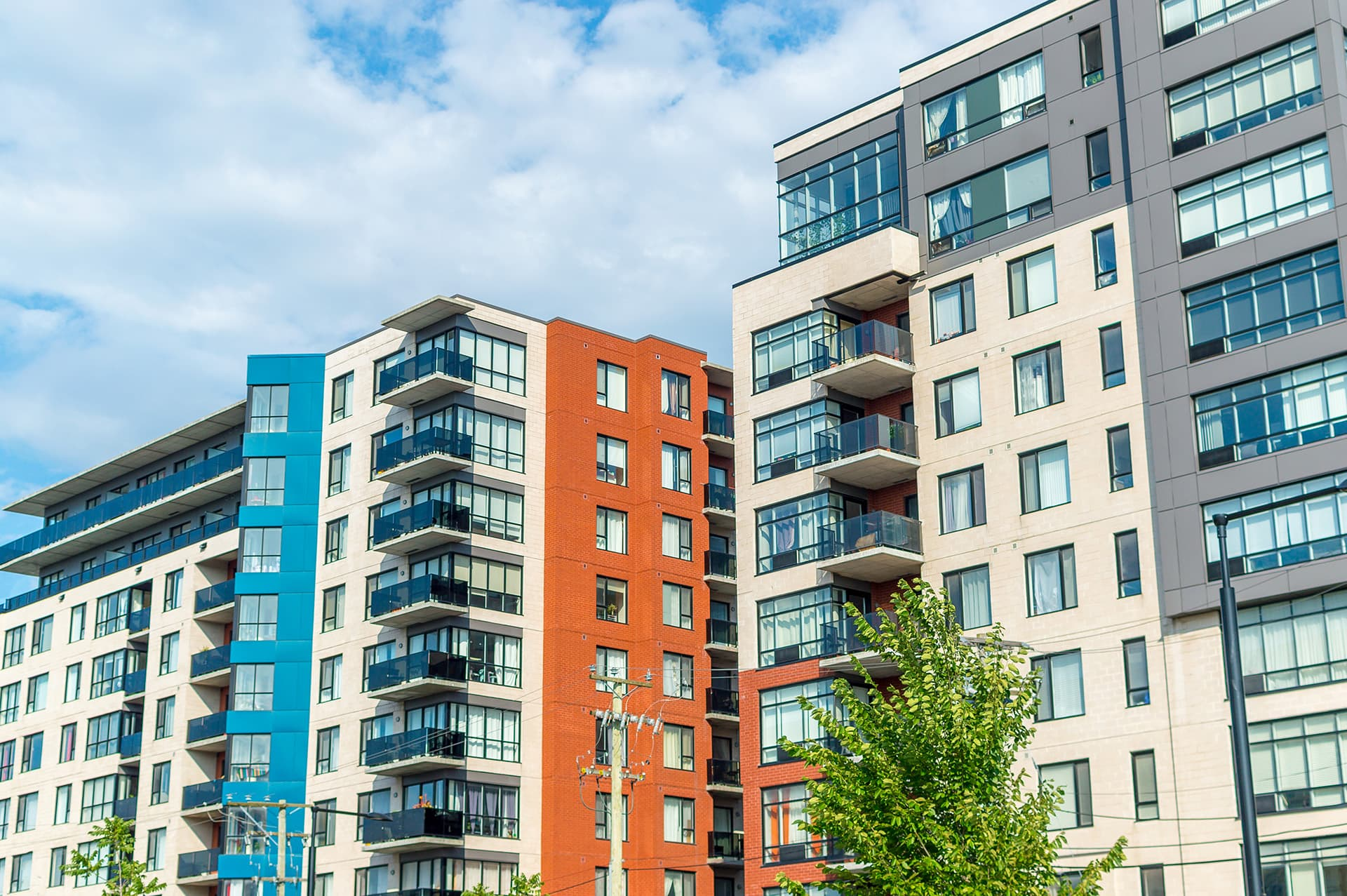 Two small condominium buildings with condo insurance