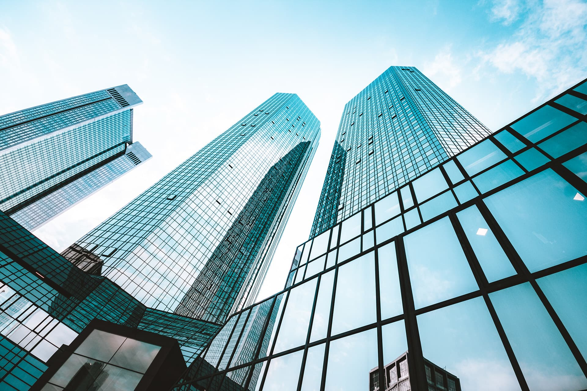 Tall glass buildings covered by office professionals insurance