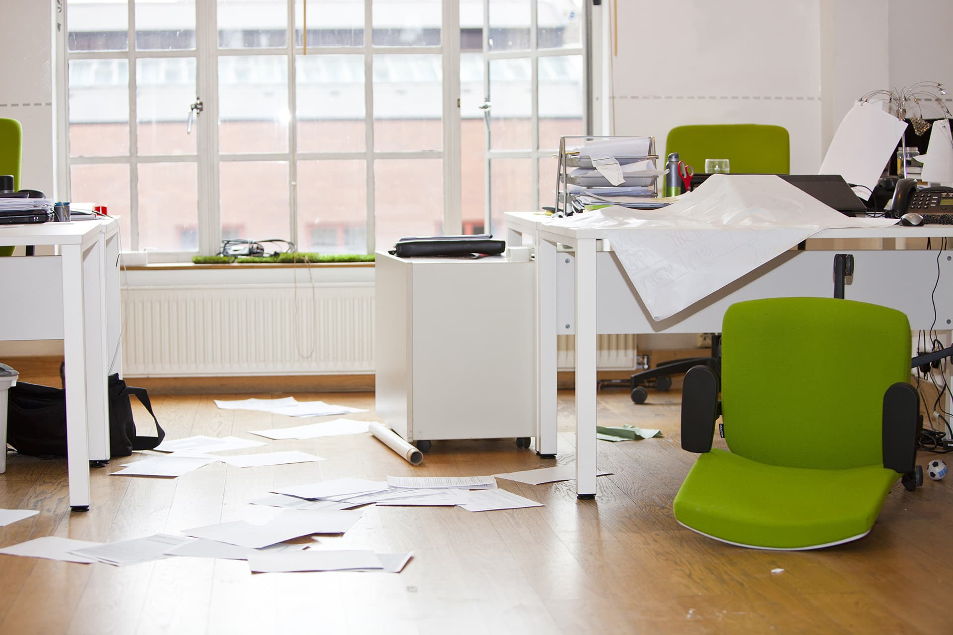 Messy office after a break and enter with commercial property insurance