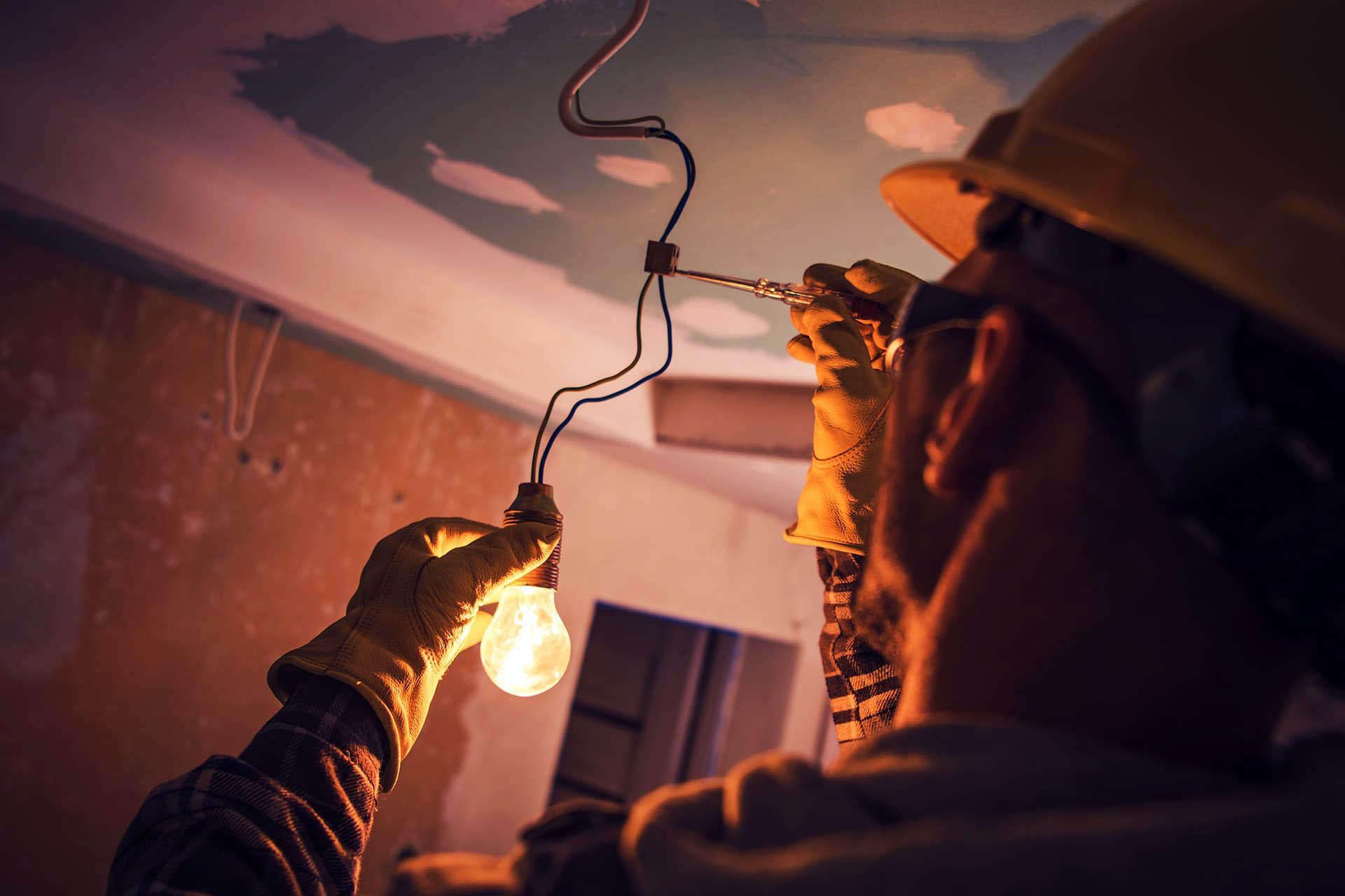 Electrician insurance for man connecting wires