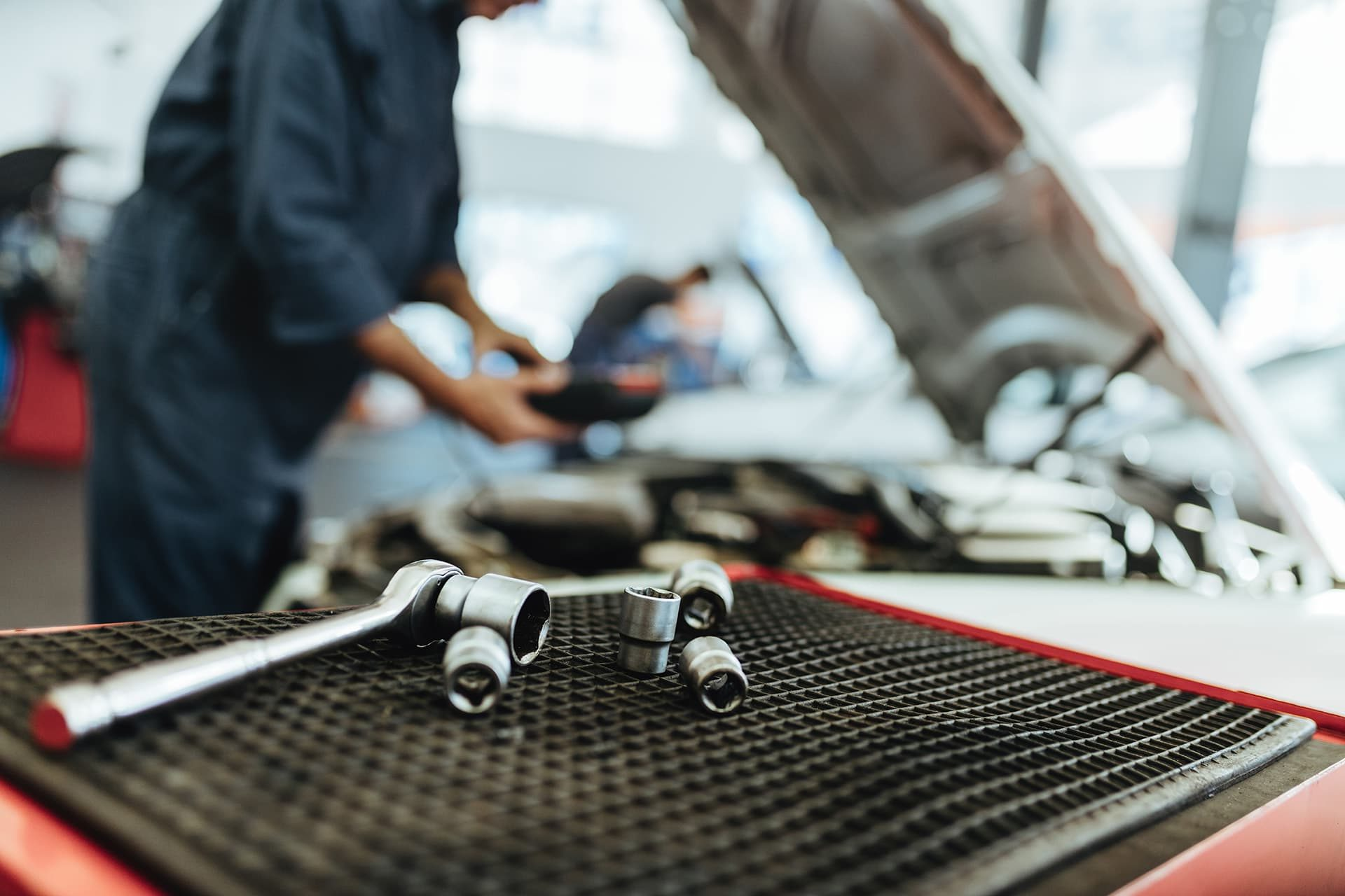 Tools in a mechanic shop with auto garage insurance