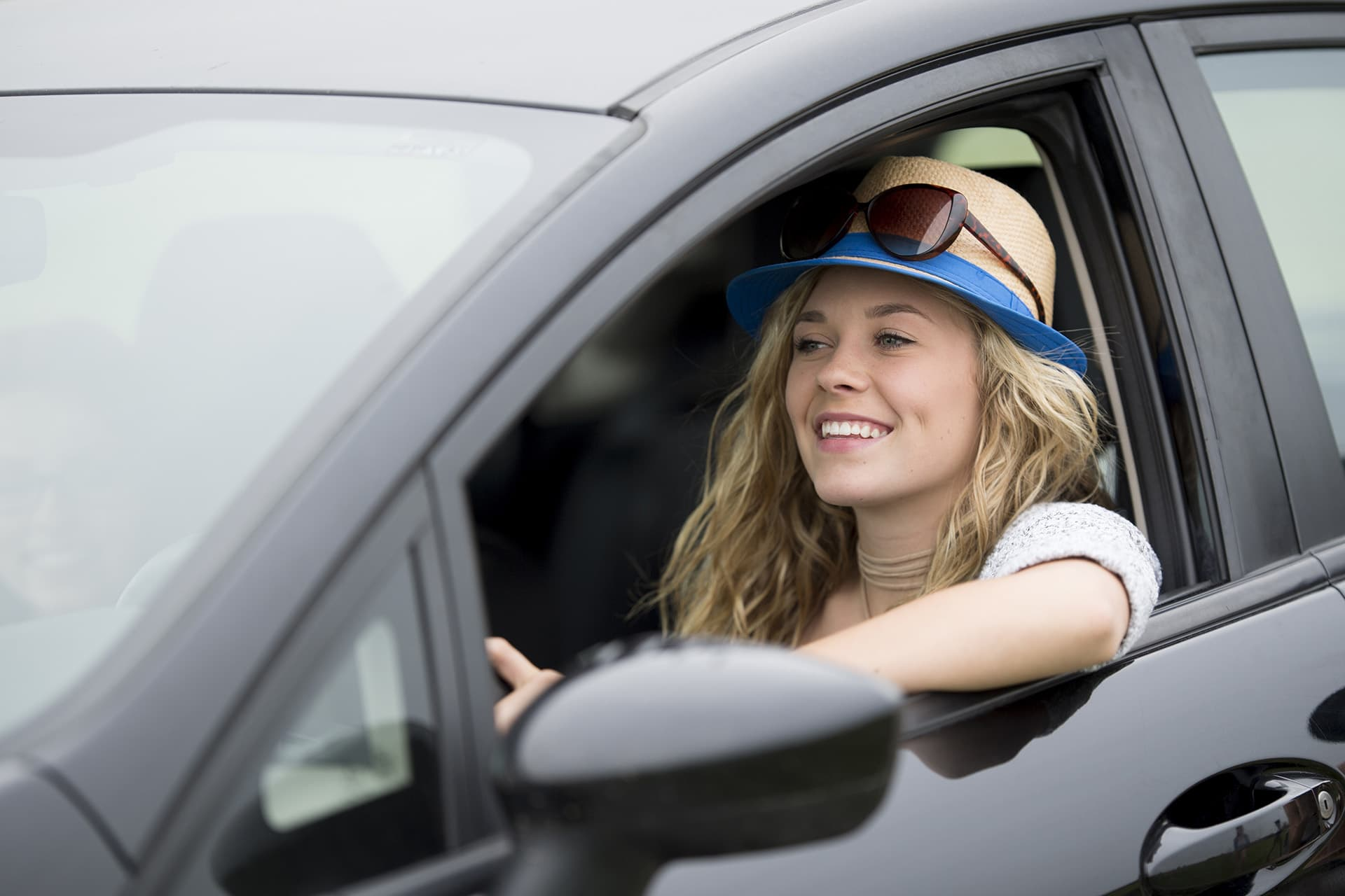Young woman in a car with new driver insurance