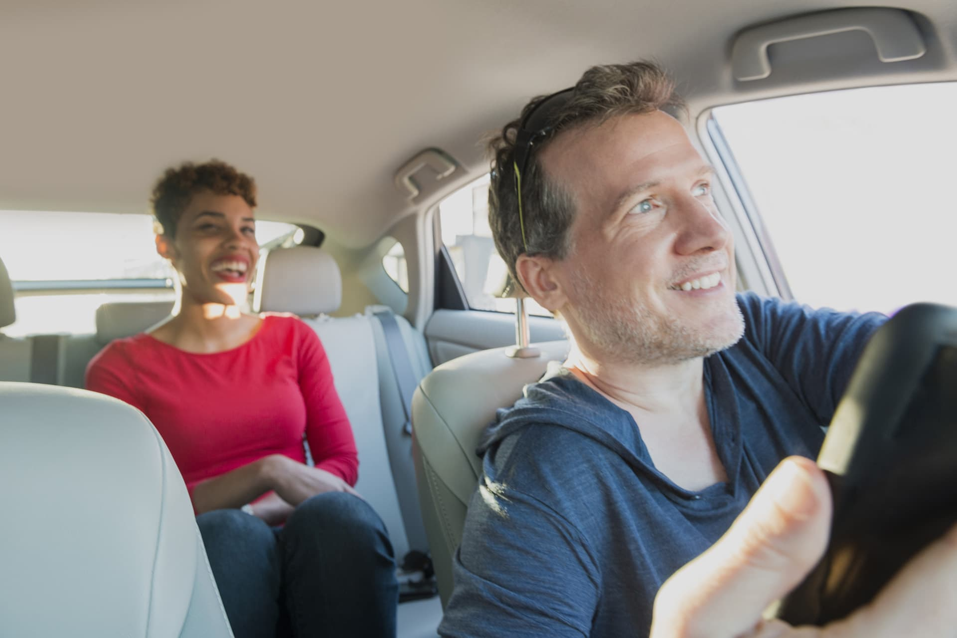 Ride-sharing insurance for male driver with female passenger in the back of his car