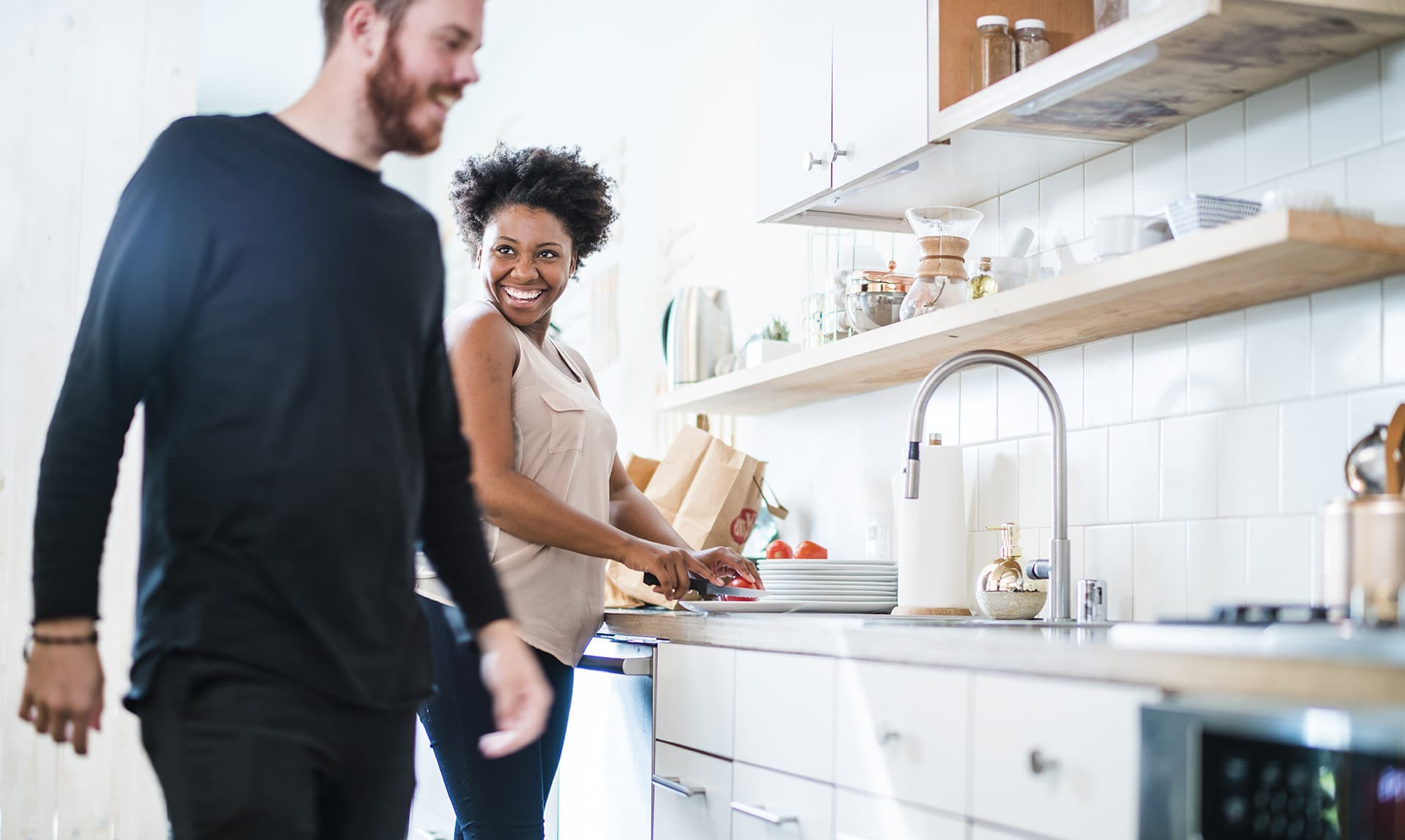 Couple making food in the kitchen with supplemental insurance