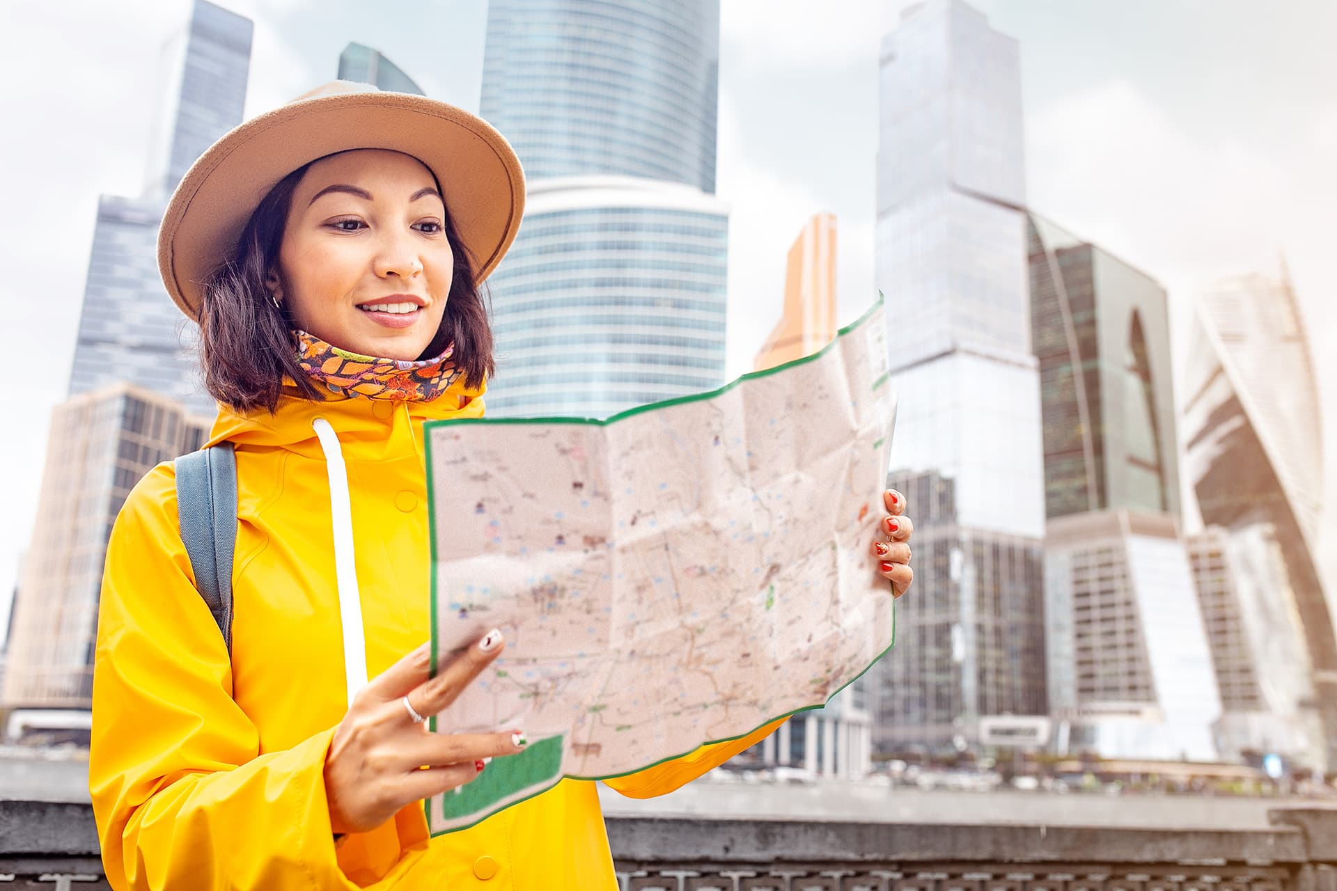 Canada visitor insurance for woman looking at a map in the city