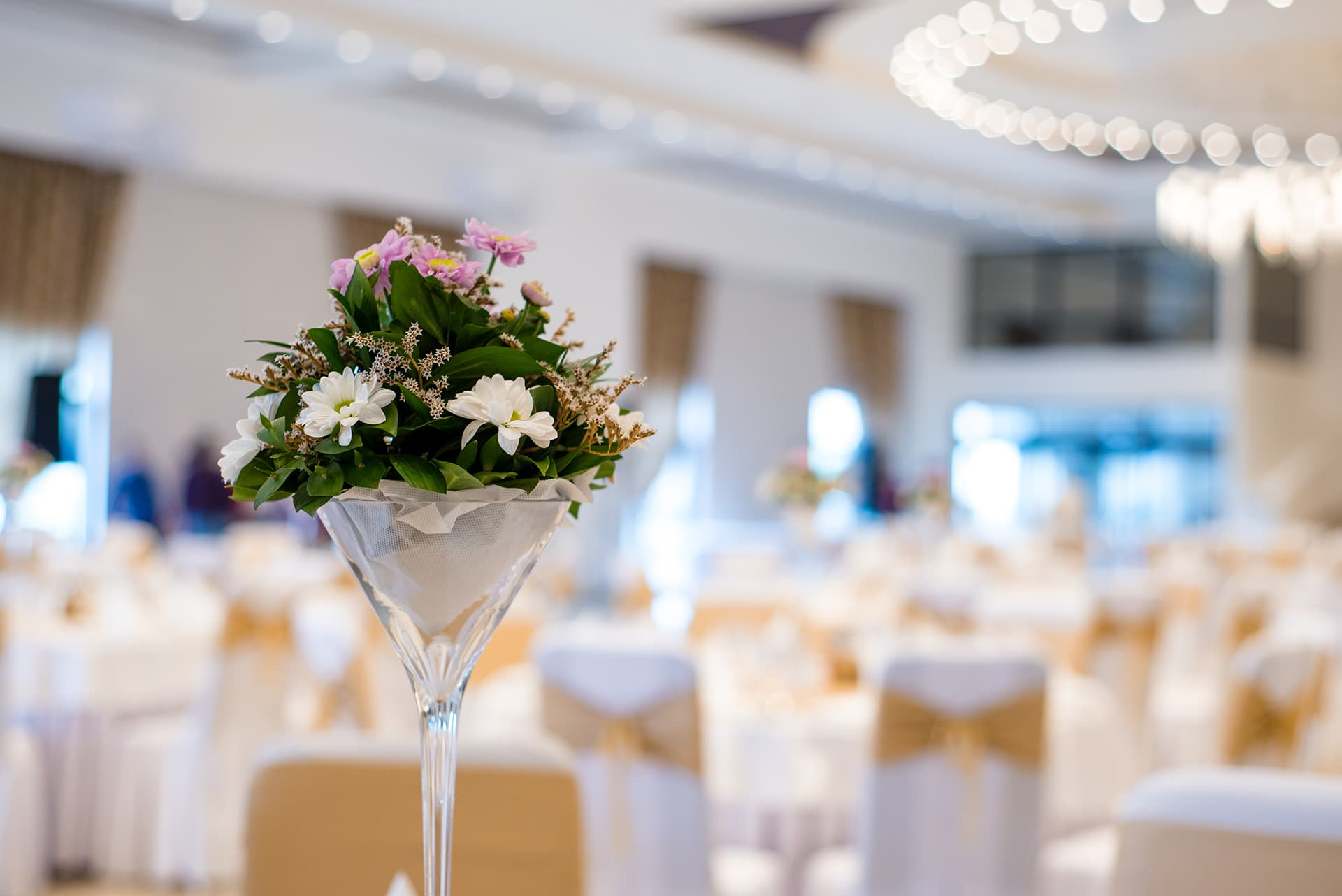 Event planner insurance at a wedding with a martini glass filled with flowers