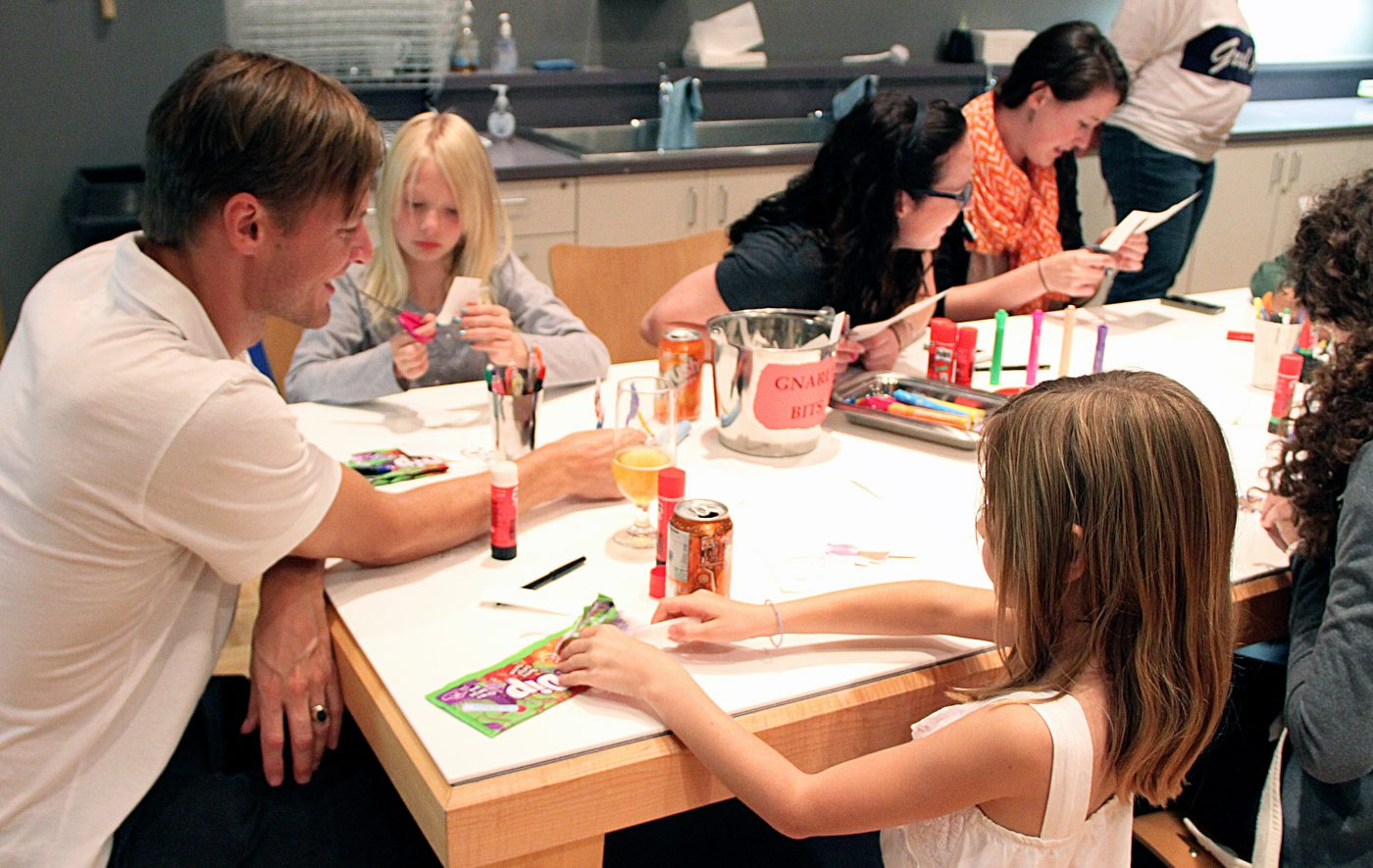 Families participate in art activities in the Discovery Room.