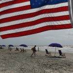 Lockdown-weary Americans hit the road to U.S. holiday weekend