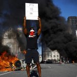 Protesters destroy police property, smash and burn cars as riots continue across US