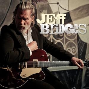 Le musicien Jeff Bridges avec sa guitare