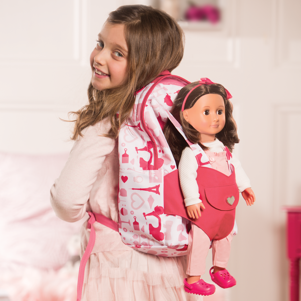 Girl wearing backpack with Noa inside