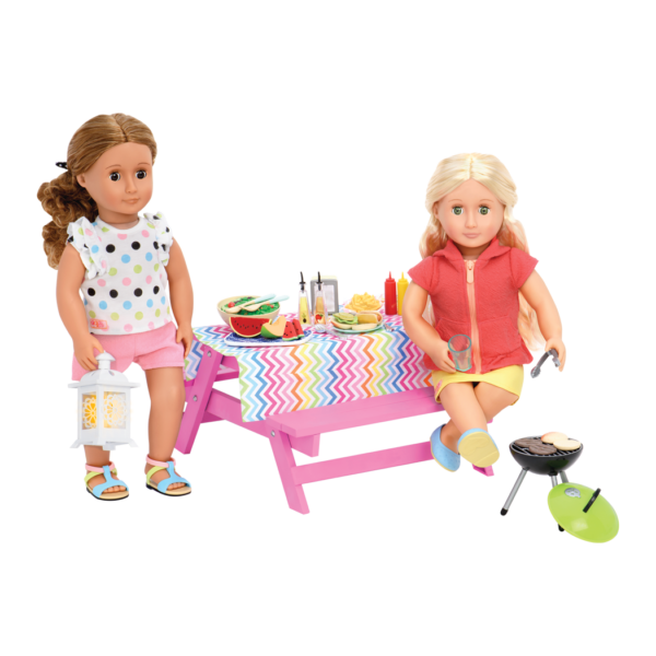 Isa and Ginger sitting at picnic table