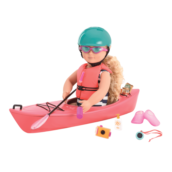 Coral in kayak with helmet on