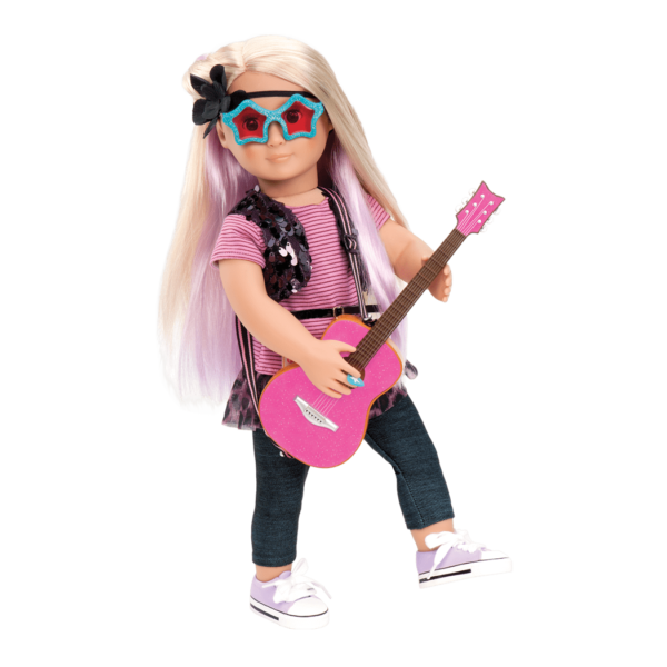Layla wearing rockstar outfit and holding guitar