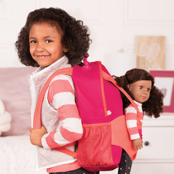 Girl wearing Hop On Carrier Backpack Bright Dots with Denelle in harness
