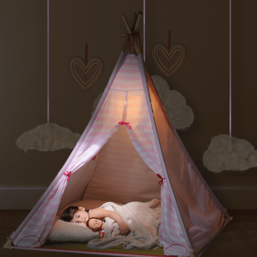 Girl sleeping at night in Suite Teepee with doll