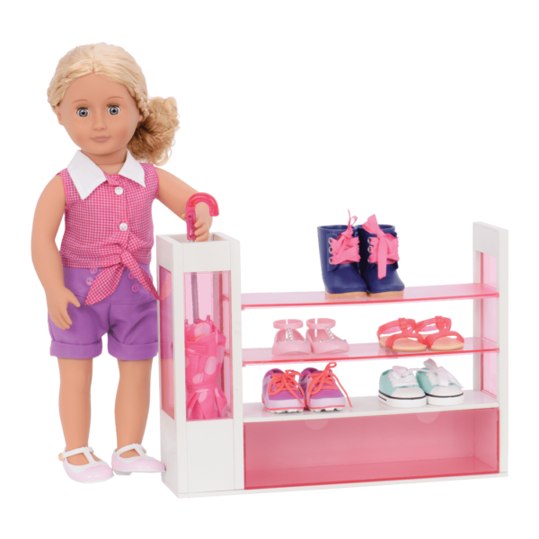 Coral posing in front of shoe rack and placing umbrella in stand