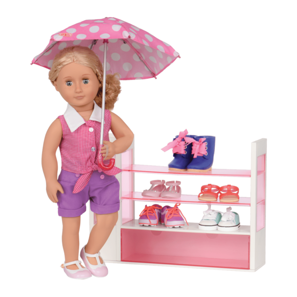 Coral posing in front of shoe rack with umbrella