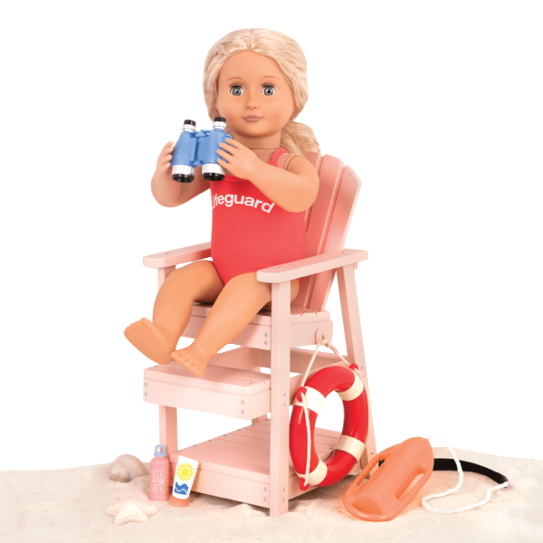 Coral sitting in lifeguard chair with binoculars
