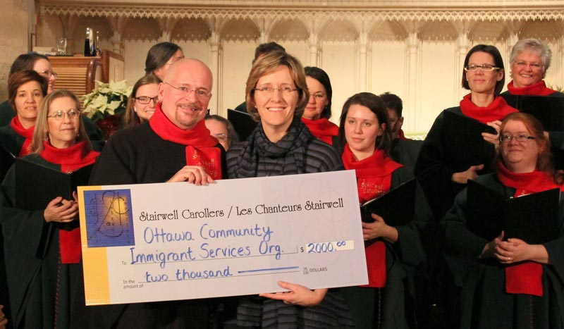 Stairwell Carollers present their donation to OCISO