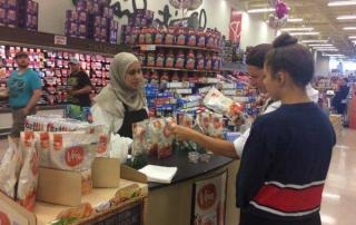 Ola Kassif, a RAISE program client, working in supermarket picture #1