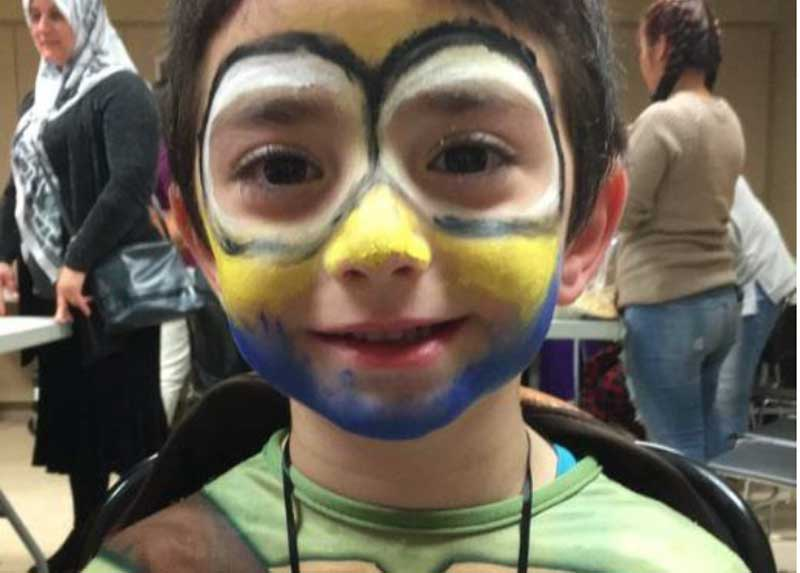 Newcomer child with face paint