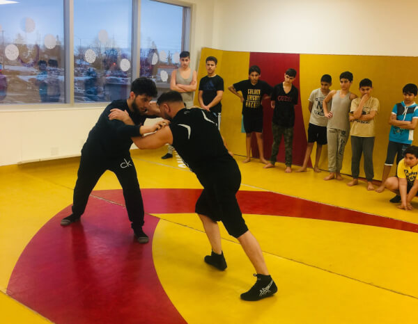 Youth participating in YOCISO wrestling program
