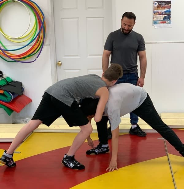 YOCISO Wrestling with Champions participants training