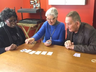 Seniors program clients playing cards together