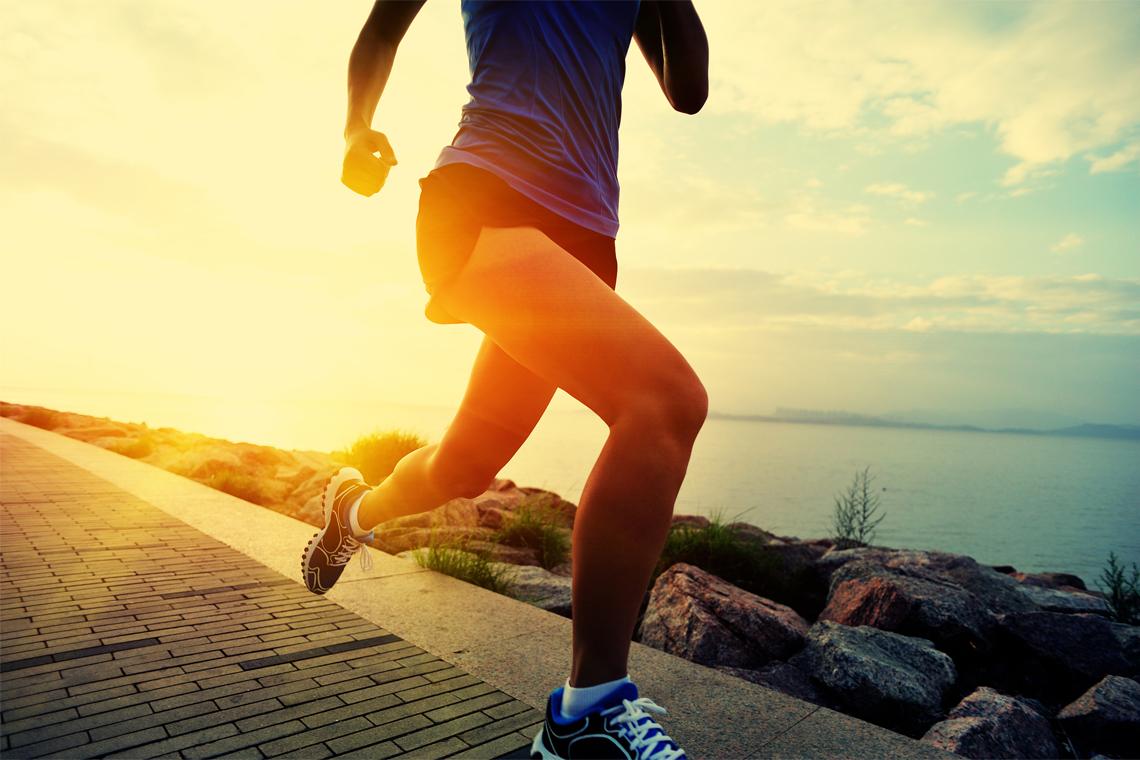 running along water at sunrise