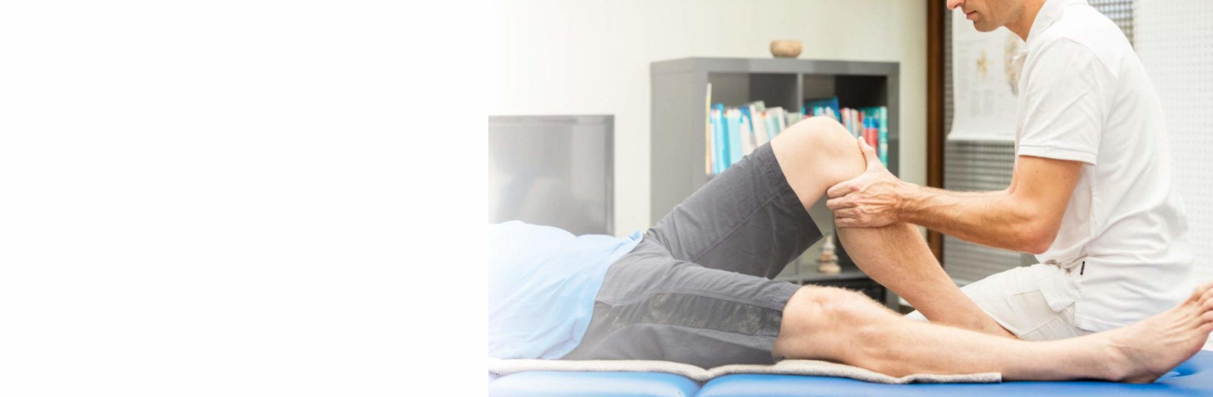 physiotherapist manipulating knee