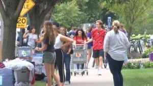 Winona state students move items into dorm rooms