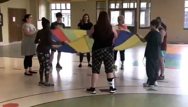 Students exercise with a parachute top