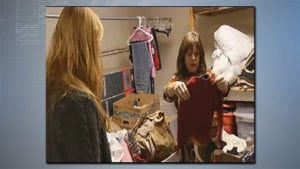 Kari Tikal looking at donated clothes