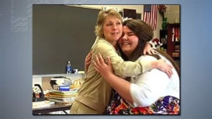 photo of Laurie Kessler hugging student