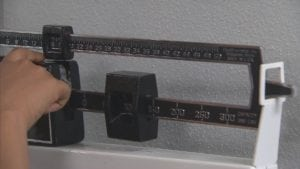 A mechanical weight scale in a doctors office