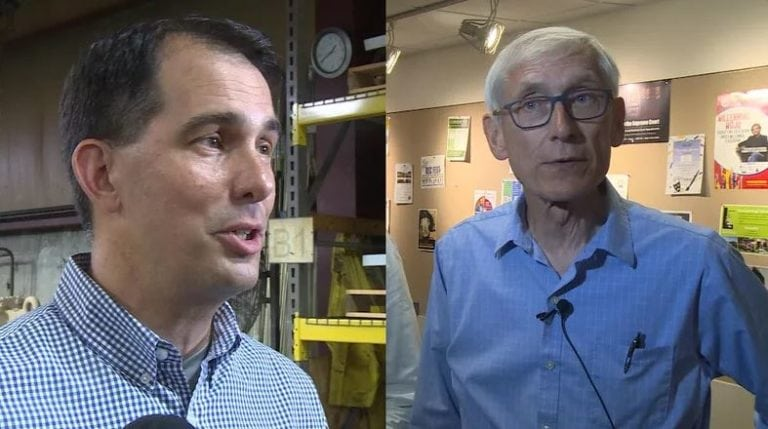 Governor Scott Walker and Tony Evers talking