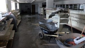 Shelves sit bare as flood water damaged goods at an Ontario gas station.