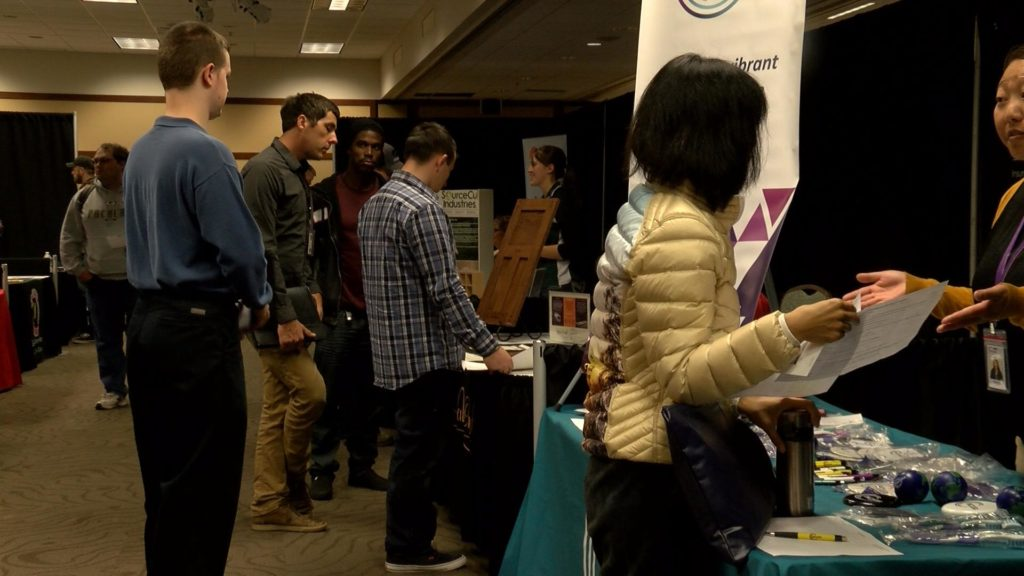 Public speaks with employers at WTC Career Fair.