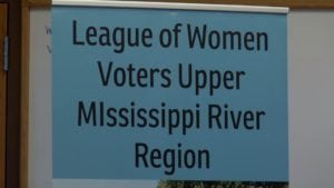 Sign reads League of Women voters Upper Mississippi River region