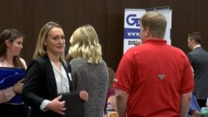 Students look around at businesses attending career fair.