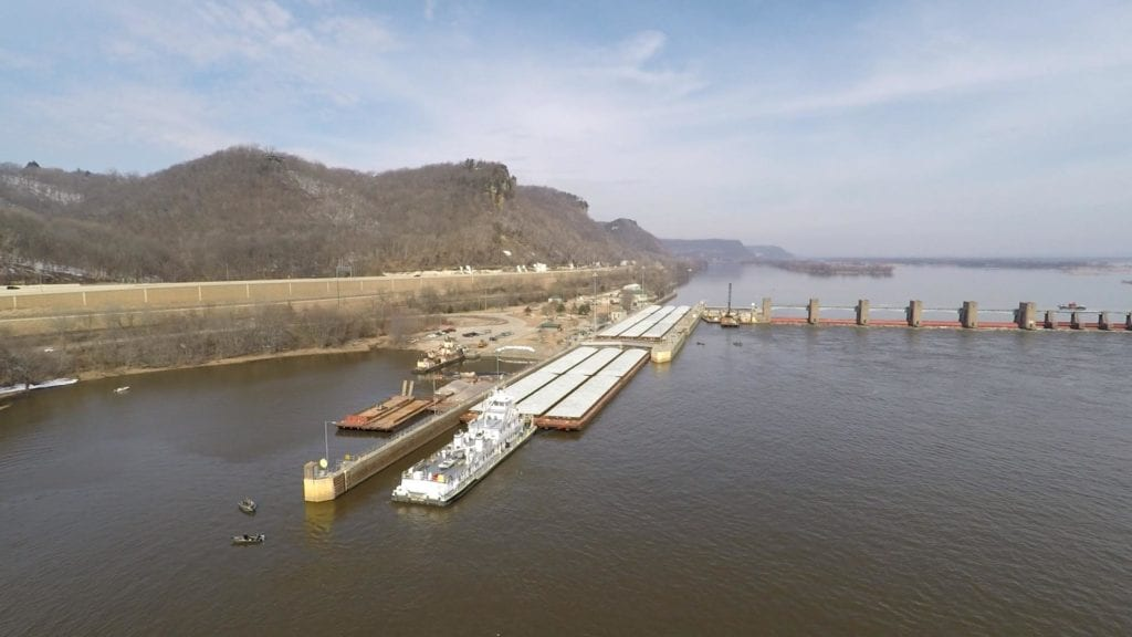 Barge traffic approaches Lock and Dam 7.