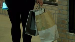 Shopper carrying bags around.