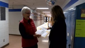 Member of the La Crosse Public Education Foundation Board hands out grant.