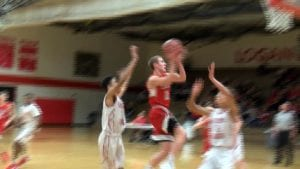 Hortonville's Mitch Tendeski drives in for a lay up.