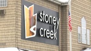 Stoney Creek sign on front of hotel.