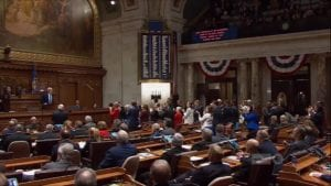 Wisconsin Legislature Democratic members applaud Governor Tony Evers during State of State speech.
